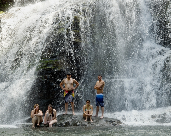 Posers enjoying the cool spray at the Nauyaca waterfall.